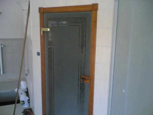 Drzwi wewnętrzne, szklane z obudową drewnianą
